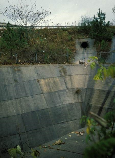 Culvert discharge into concrete-lined detention basin. Credit: Robert Pitt, Ph.D., P.E., D.WRE