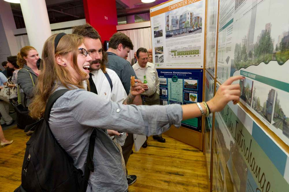 Attendees view an exhibit of green infrastructure designs before the Infill Philadelphia: Soak It Up! design competition launch. Photo credit: Mark Garvin