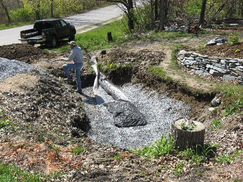 Rain garden drainage and gravel going in