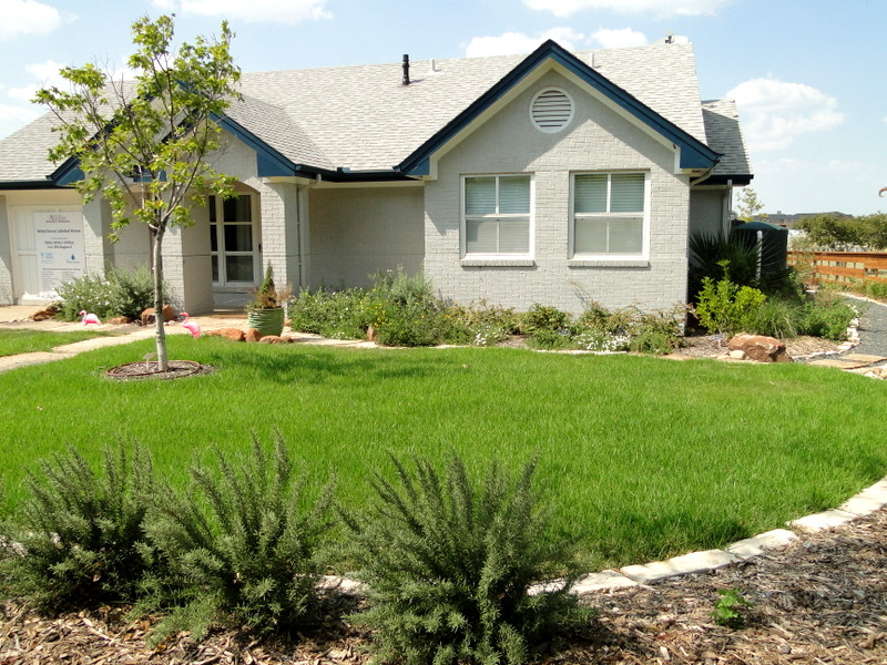 In addition to research, the Texas A&M AgriLife Research & Extension Center at Dallas also outreaches to area residents on ways to reduce stormwater pollution and conserve water. Pictured here is the WaterSense Labeled Home complete with a rainwater harvesting system.
