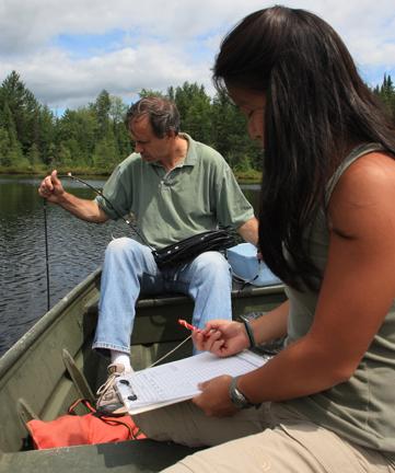 University of Virginia (U.Va.) environmental scientist Michael Pace and former U.Va. student Carol Yang conduct a water study.