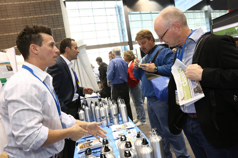 Exhibitors discuss their products and services with attendees.