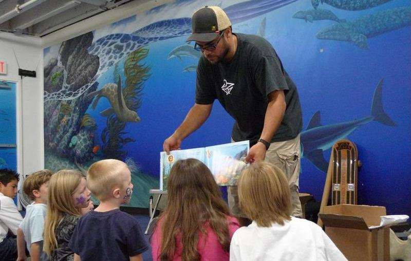 Author Joel Harper reads All the Way to the Ocean to children at the Santa Monica Pier Aquarium.