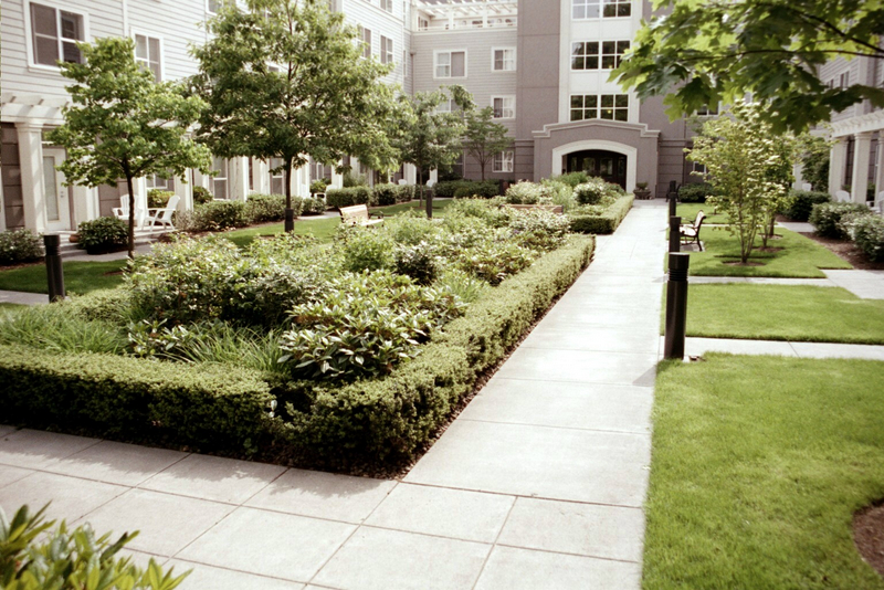The character of green infrastructure designs can range from naturalistic to formal. These manicured rain gardens offer outdoor spaces for residents to step out, gain green benefits, and then return to busy lives. Photo credit: Kathleen Wolf