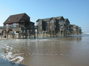 Houses in Rodanthe, NC, are left in the waves at the ocean's edge following the passage of Hurricane Isabel, which made landfall as a category 2 storm in the Outer Banks on September 18, 2003. U.S. Geological Survey/photo by Hilary Stockdon