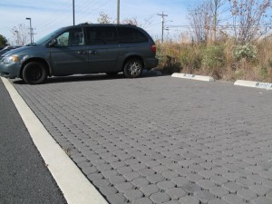 WSSI's concrete pavers reduce impervious area by 511 sq m (5,502 sf), and drain to an existing vegetated floodplain. They cost $76/sq m ($7.10/sf) to install. Image credit: WSSI
