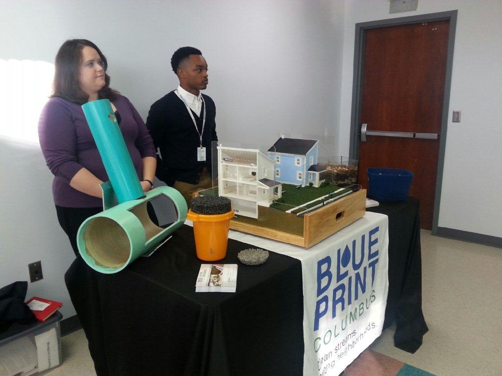 Members of the Blueprint outreach team stand ready to explain to small business owners how residential storm runoff causes issues with our sewer system using a model home specifically created for the Blueprint initiative.