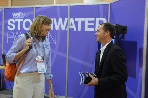 Theresa Connor of the Water Environment Research Foundation talks to an attendee after her presentation in the Stormwater Pavilion Theater. Image credit: Oscar & Associates