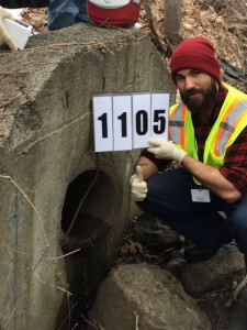Student volunteers assist the Town of Lexington with monitoring outfalls for illicit discharges. Photo by Town of Lexington