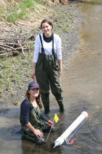 Students Halya Petzold (back) and Brittany McWhirter (front) examine sediment traps in the South Tobacco Creek Watershed. Image by David Lobb