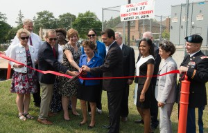 Public officials from state and local government as well as representatives of the Metropolitan Water Reclamation District of Greater Chicago and U.S. Army Corps of Engineers cut the ribbon on the new Levee 37 project. Image provided by MWRD