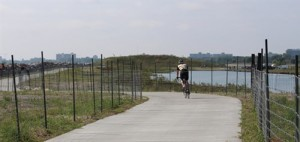 A cyclist enjoys new trails on Northerly Island. Image by the Chicago Parks Department