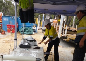 Katarina David (left) of the UNSW Connected Waters Initiative preserves samples of moist rock at a drilling site near Sydney for later testing in the laboratory. Image by UNSW