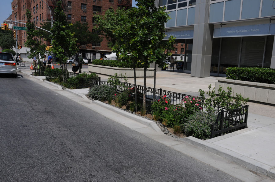 Completed rain gardens include a notch in the curb to allow stormwater to flow in and plants to beautify the garden as well as aid in evapotranspiration of the collected water. Photo credit: NYC DEP